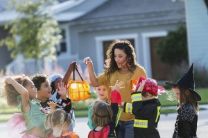 woman-giving-candy-to-children-on-halloween-300x200